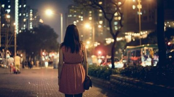 girl walking at night